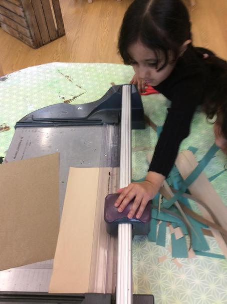 We used the guillotine to cut strips in paper.