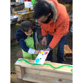 Fingerpainting flowers onto our new planters