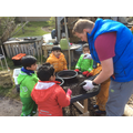 Sieving soil to find rocks and roots