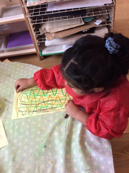We practised drawing wavy lines using pastels.