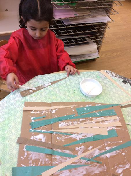 Then we glued our strips down.