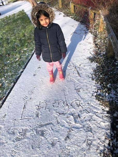 Inaya has been playing in the snow today and even practised writing her name.