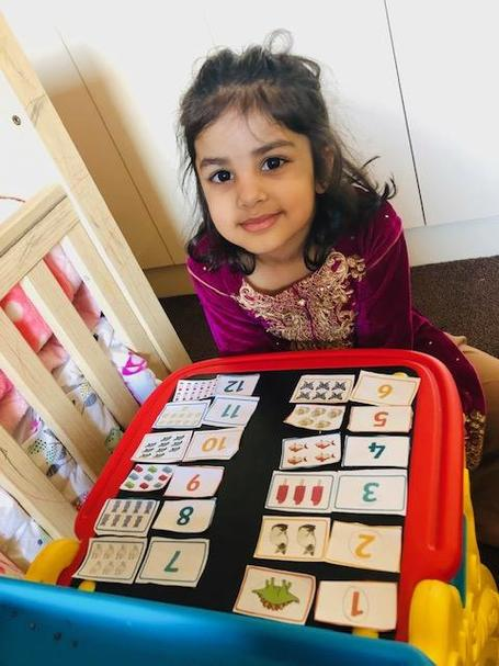Inaya has been matching number to quantity in maths.