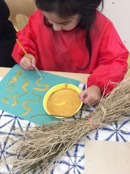 We used thin paint brushes to paint wavy lines too.