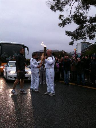 Sir Bobby Charlton carrying the torch