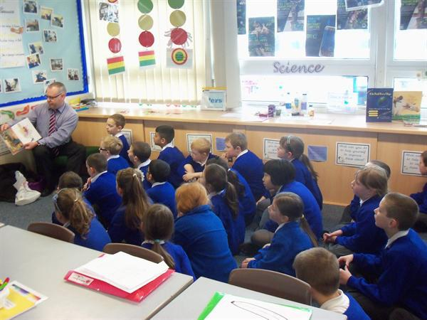 Mr Harthill reading to us!