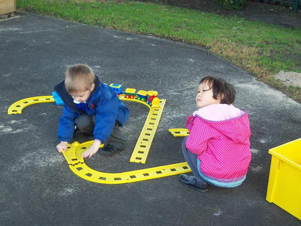 Frazer and Nicola assembling the train track