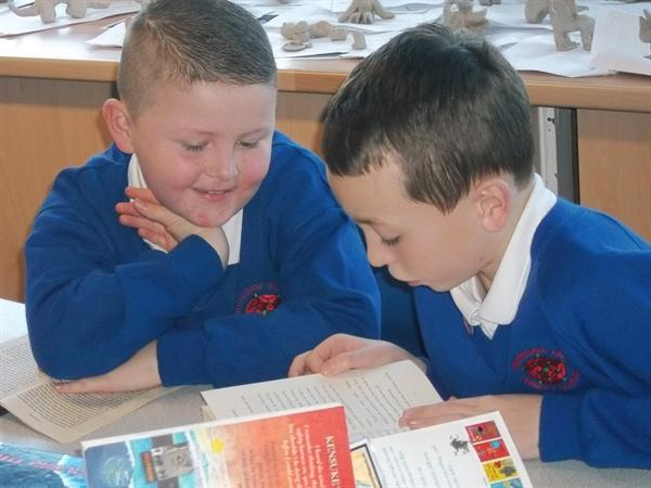 Buddy reading with Year 3