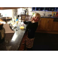 Children enjoying cooking their muffins at home!