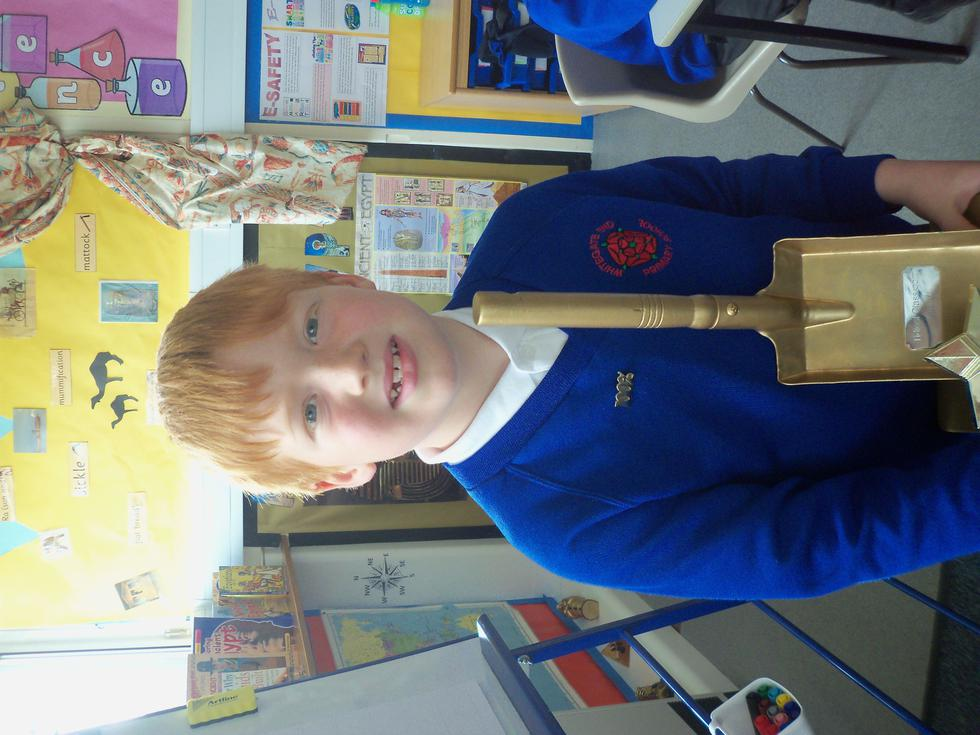 Tom proudly showing off his trophies!