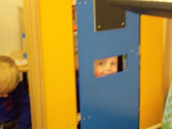 Who is that behind the door?