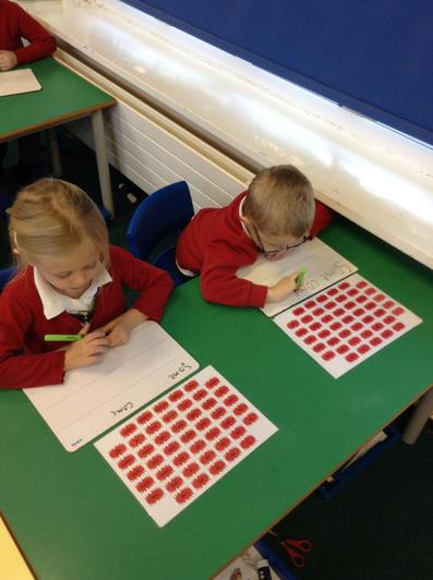We use our sound mats to help us write 'red' or 'tricky' words.
