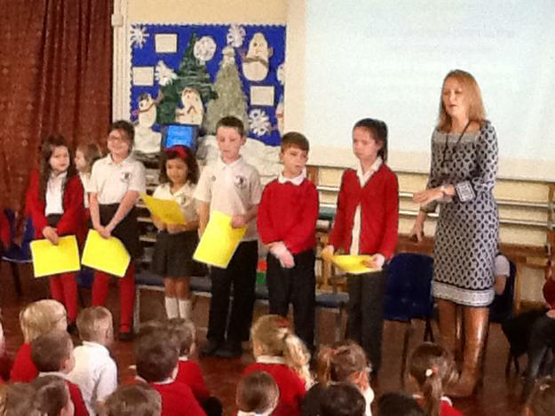 School councillors leading an assembly