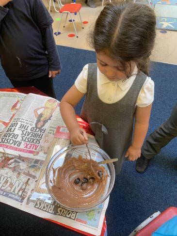 Making chocolate fruit skewers
