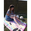 Izzy enjoying the sunshine with a good book