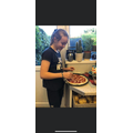 Evie making a pizza