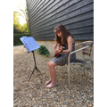Cora playing the guitar for her neighbours!