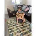 Finley playing the guitar