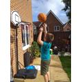 Oscar is practising basketball.