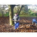 Starfish helpers cleaning up forest school