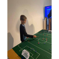 Relaxing with a game of Subbuteo