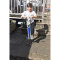 George learning to pogo-stick!