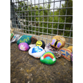 Pebbles decorated with hope messages