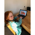 Libby playing on EducationCity