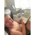 Reading his books.