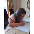 Livinia working hard with her writing.
