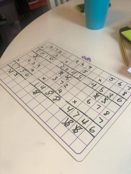 Zak has challenged himself in his multiplication maths work.