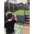 Lewis playing darts!