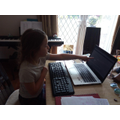 Livinia using her Mum's old laptop
