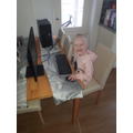 Lola has been help her Mum set up the computer