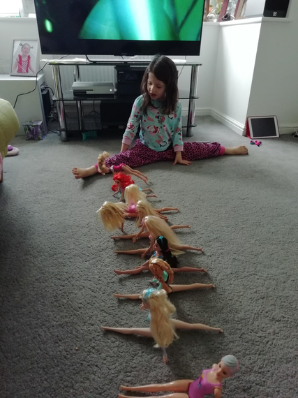 Lucy and her Barbies doing their daily exercise
