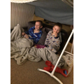 Building a den with his brother