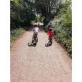 Lucy and her brother out on their bikes.