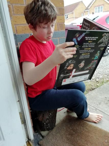 Henry J has been reading in interesting places on World Book Day!