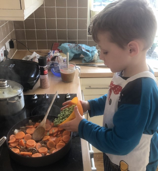 Helping with cooking tea