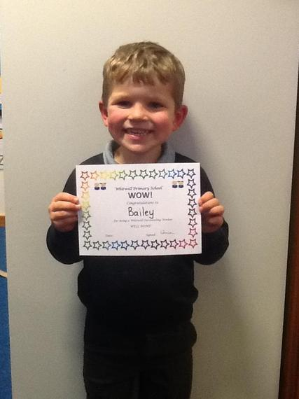 Bailey loves to write and draw all of the time. He has learned to write 'B' for Bailey!