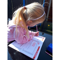 Lola pretending she is doing some Maths work!