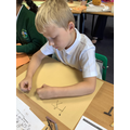 Using charcoal to create stone age style drawings