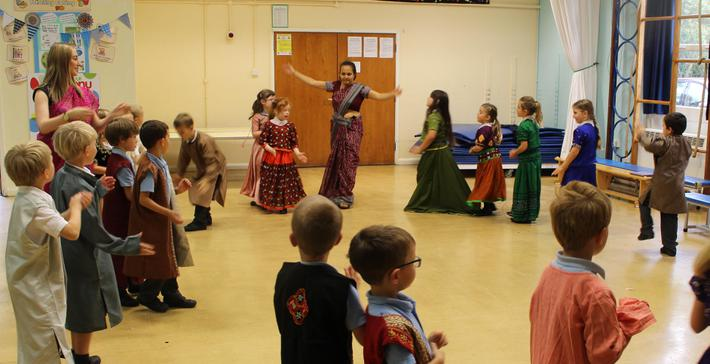 Mita teaching a traditional Indian dance to Deer class