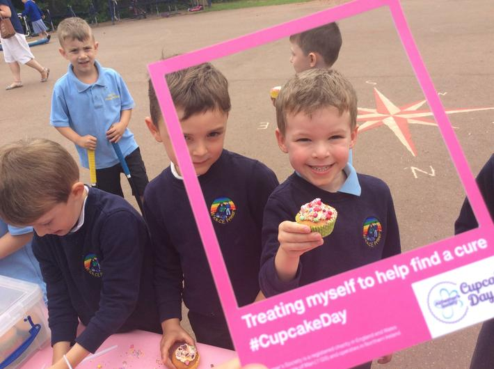 Enjoying our cup cake fundraising day