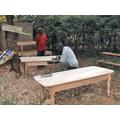 Local craftsmen making the childrens desks