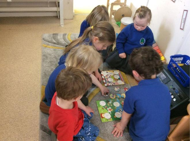 The nursery children chose to play a rhyming game using the CD player.