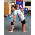Practising counter balances in gymnastics.
