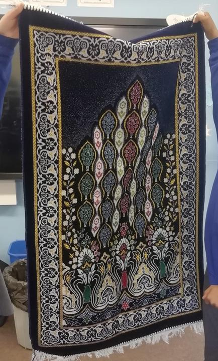 A prayer mat.  Year 3 were interested in the beautiful geometric patterns.