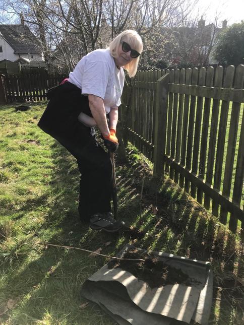 Janet planting the last tree.