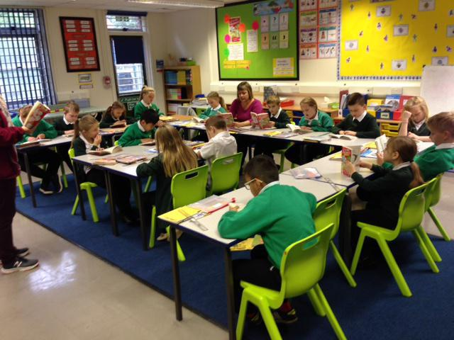 Children engrossed in whole class reading